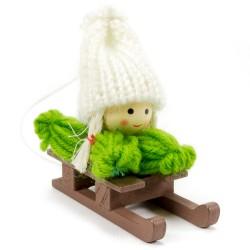 Ozdoba na vianočný stromček - dievčatko zelené na sánkach